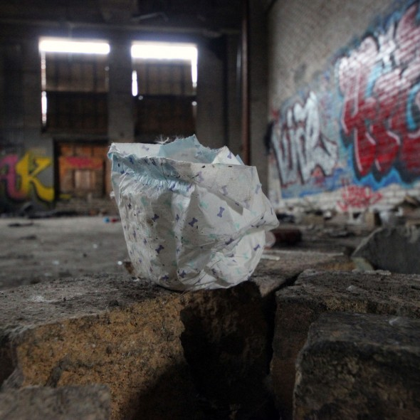 Strange Finds - Small diaper in an abandoned building by Courtney Celley