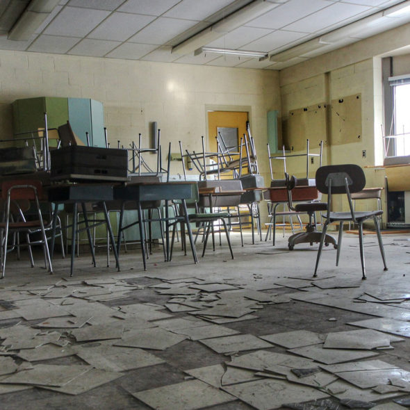 Piled Desks in an Abandoned School by Courtney Celley