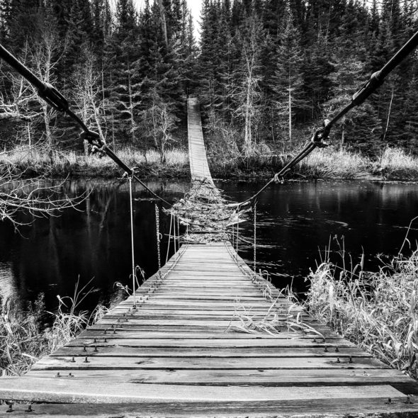 Abandoned cable bridge by Courtney Celley
