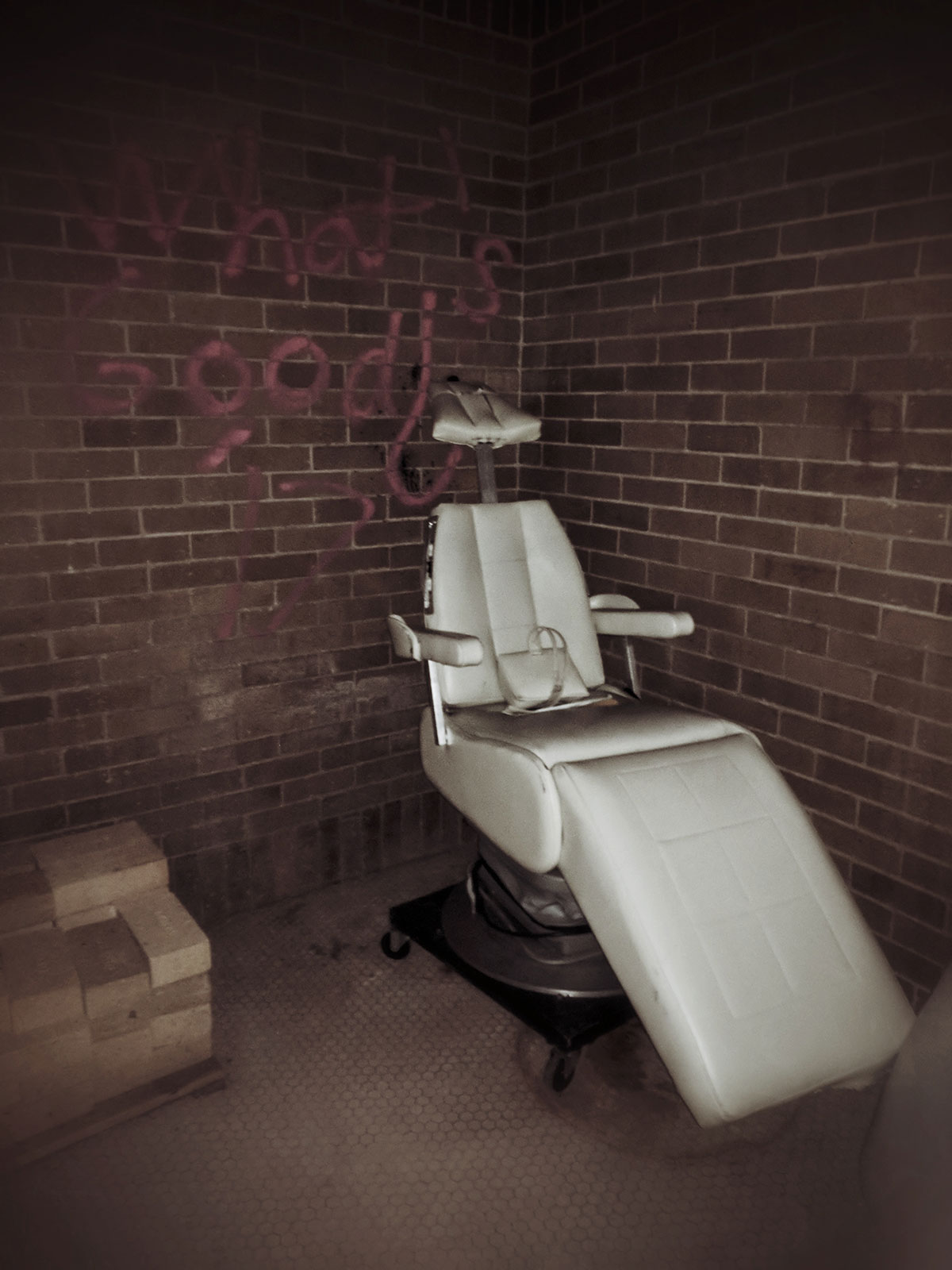 Old Dentist Chair in a Basement by Courtney Celley