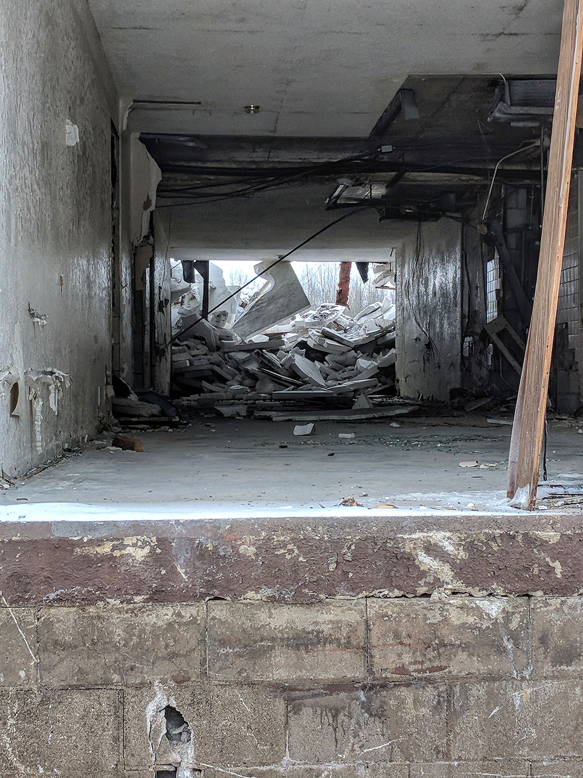 Abandoned building demolition by Courtney Celley